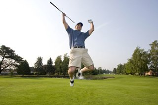 golfer jumping in the air